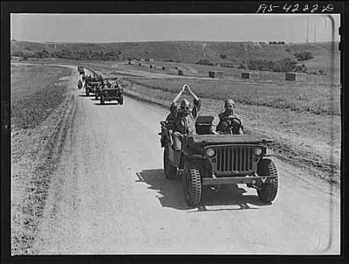 Troops on the move near Fort Riley, Kansas - April, 1942.
