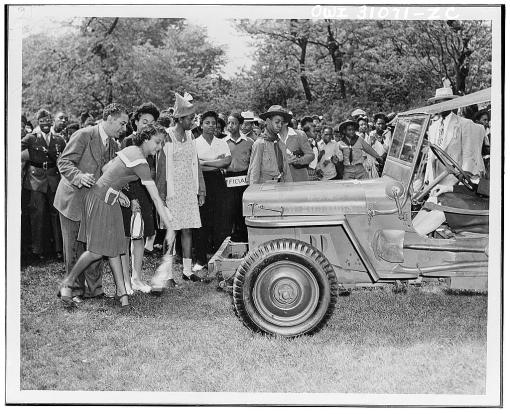 Chicago school children collect enough money to purchase many jeeps, planes and a motorcycle.