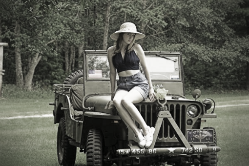 WW2 jeep girl with a WW2 jeep grill.